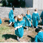 children-in-blue-t-shirts-helping-landscape-a-PLL-home
