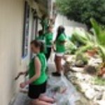 young-teens-painting-outside-of-PLL-home