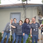 volunteers-cleaning-up-lanscape-in-backyard-of-home