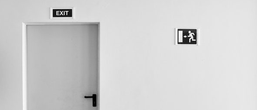 white door with an exit sign