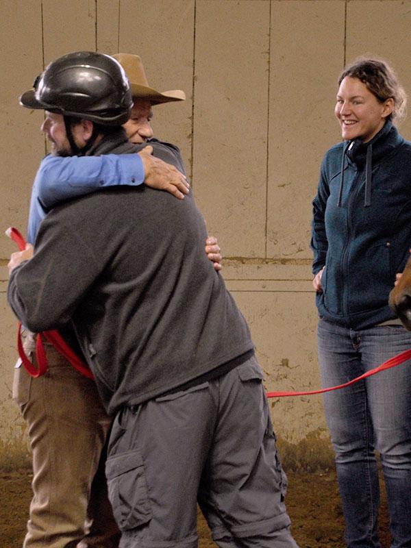 Monty Roberts and Denise Heinlein with veteran at Horse Sense & Healing workshop