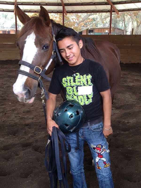 Guatemalan teen with a horse at Lead-Up Guatemala program