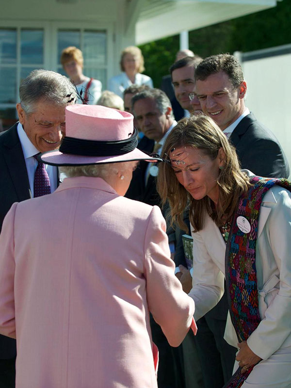 Lead-Up International founder Katie Cunningham Pokorny receives an award from the Queen of England
