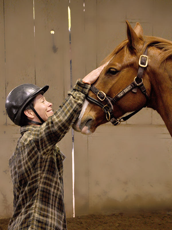 Moment of Join-Up between veteran and horse wearing Dually halter