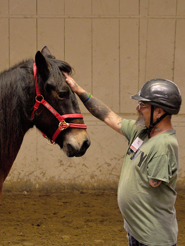 American veteran experiences moment of Join-Up with a horse at Join-Up International's Horse Sense & Healing program