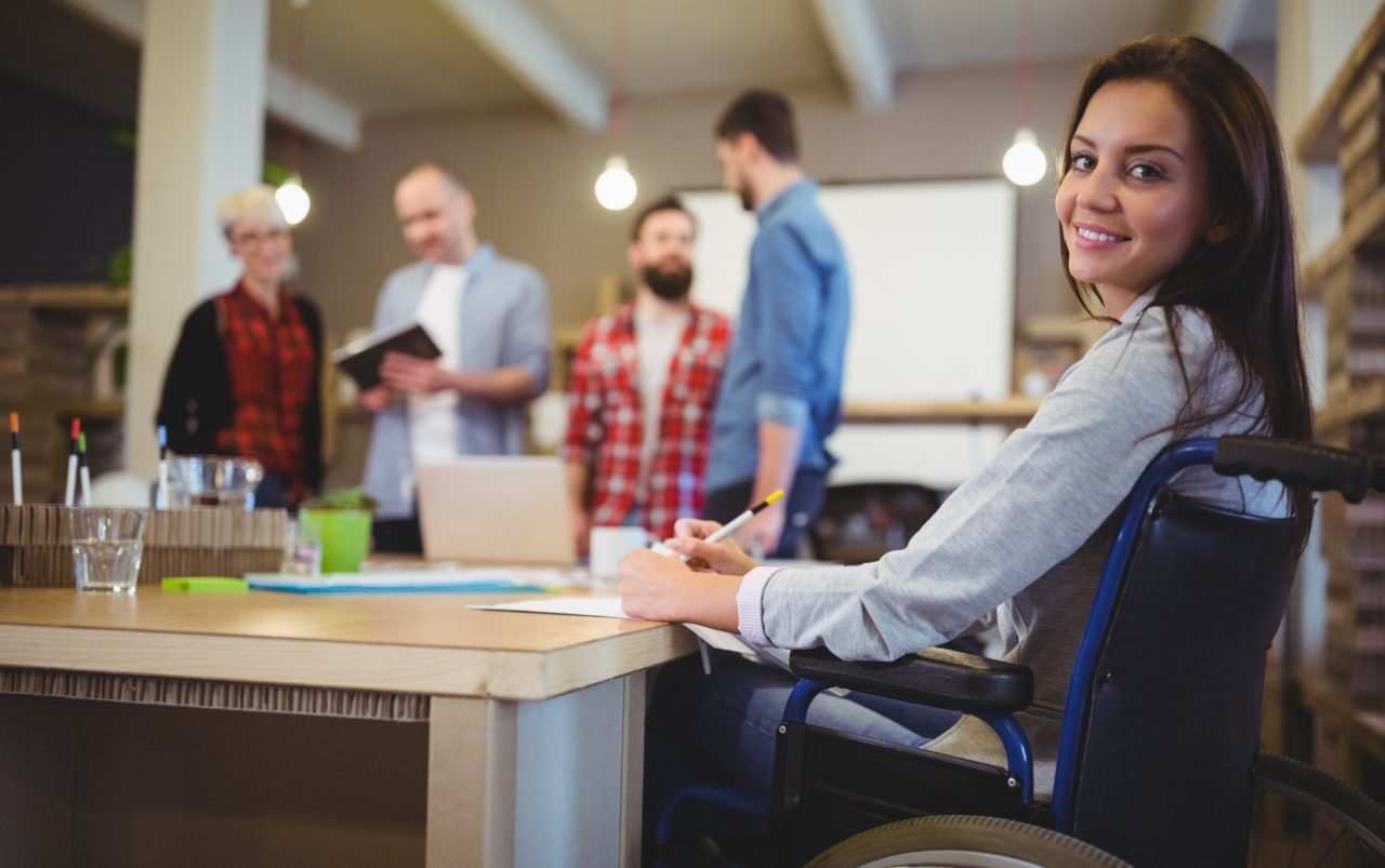 Woman in a wheelchair at work