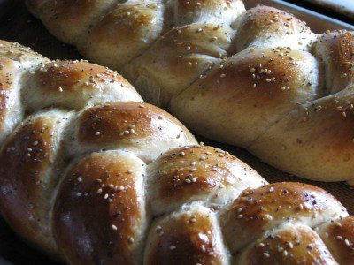 Challah bread loaves, shown here with poppy and sesame seeds