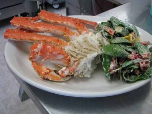 Norton Sound Red King Crab Leg section with side salad- we often offer this for lunch often, when crab is in season
