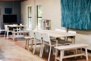 Tables and chairs in a coworking space. Coworking & working vacations