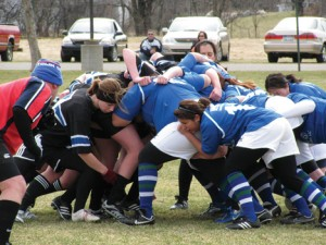 In borrowed GVSU black jerseys, the Rockford women's rugby team plays their first match against Traverse City.