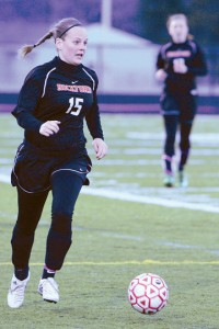 Junior outside midfielder Sondra Weaver moves the ball up the sideline.Photo by BRET DOUD
