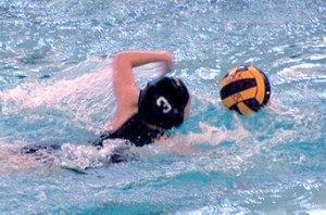 Varsity athlete Kaitlyn Cress helps her team to a season-starting win.Photo by PATRICK KEELEY