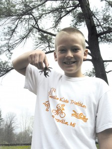 CREEKY CRITTERS—(left) Ben Johnson, 9, shows off one of the Creeky Critters from that booth. He is from Kentwood, and was visiting for the day with his grandmother who lives on Lake Bella Vista.