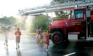 FIREMEN LIKE TO SPRAY THINGS WITH WATER—If it's hot for National Night Out, Rockford firefighters will turn on the hoses and let kids keep cool.