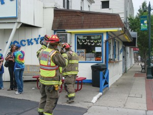 QUICK RESPONSE—(above) Firefighters prepare to enter a smoking Rocky's on the corner of Main and Courtland streets Friday, July 17, after they received a call that one of the ice cream machines caught fire.