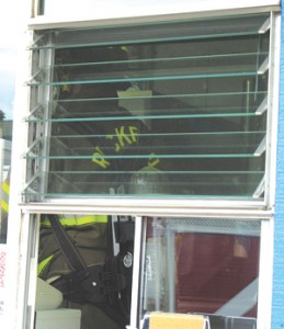TAKE OUT WINDOW VIEW—(right) A fireman inspects smoldering equipment inside Rocky's. A short in a soft-serve  ice cream machine was found to have been the source of a fire which required the shop to close from Friday after the 5 p.m. fire until reopening Sunday for business.