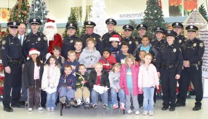 SHOPPING WITH HEROES—Someone trademarked Shop With a Cop, so this annual outing needs a new name (Shop With Our Cops?). Rockford Police took youngsters on a special shopping spree at the Rockford Meijer Sunday, December 6. After filling carts with necessities such as socks and mittens, children were able to pick out a toy of their choice.