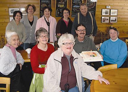 LOCAL ARTISTS HANGING OUT—Front row: Nancy Liszewski, Peggy Salk, Dana Ziebarth, Michael Callihan, and Louise Bauer. Back row: Kathlene Kalinowski, Kathlene Putham, Patti Mollema, Sue Callihan and Phillip Glass, host.