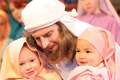 Jesus, played by Kevin Shuneson of Sparta, blesses the children.