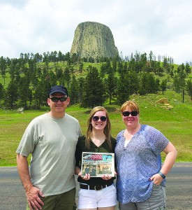 Left to Right: Chuck, Hailey and Kelly standing in front of Devils Tower National Monument.