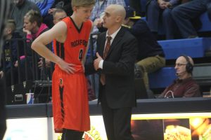Rockford senior forward Tyler Brenner (left) discusses strategy with Rockford basketball coach Kyle Clough.