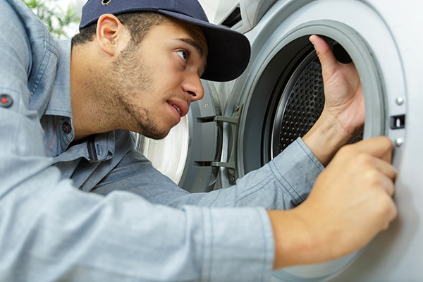 whirlpool front load washer smells
