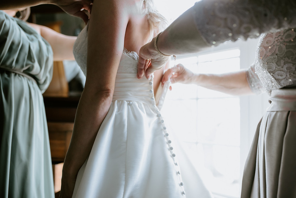 Bride to be being fitted