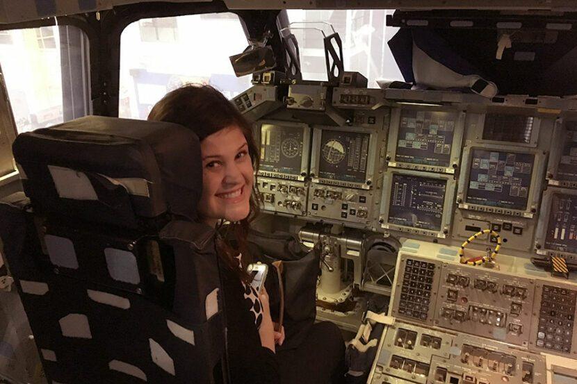 Cassandra Barnes BQMI eemployee in a shuttle mock up