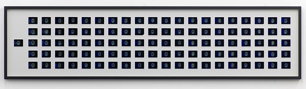 Jeremy Shaw, Transcendental Capacity (Billboard Hot 100 - 1969), 2014, 101 Kirlian Polaroids in frame, 75cm x 305.2cm x 6cm.