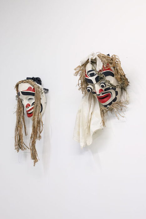 Installation View of Atlakim Masks, 2000, dimensions variable, cedar, paint, felt