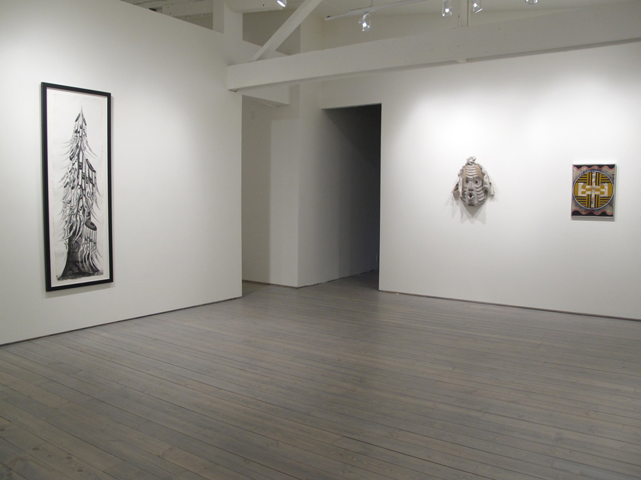 """Installation view, from left: Lawrence Paul Yuxweluptun, Old Growth Tree, 2012, Etching on St. Armand Paper, 19"""" X 65""""(image size), ed. of 25, Beau Dick, Pookmis, 2012, Cedar, horse hair, paint, cotton, 25"""" X 12"""" X 6"""", Audrey Capel Doray, Iconography, 1965, Acrylic Polymer emulsion on board, 23"""" x 17.5"""""""