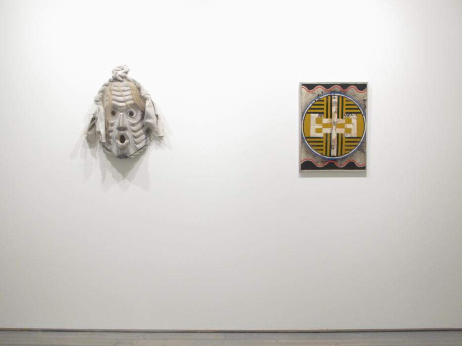 "Beau Dick, Pookmis, 2012, Cedar, horse hair, paint, cotton, 25"" X 12"" X 6"", Audrey Capel Doray, Iconography, 1965, Acrylic Polymer emulsion on board, 23"" x 17.5"""
