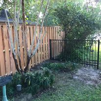 cedar and iron fence