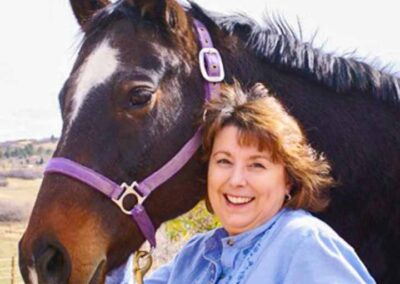 Woman smiling with horse