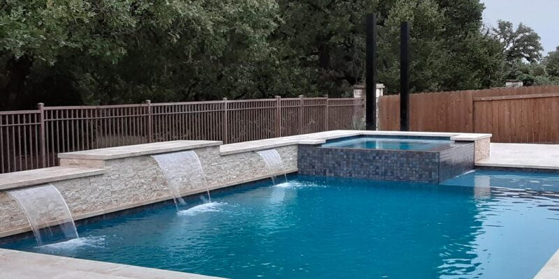 Rectangular pool with spa and waterfalls