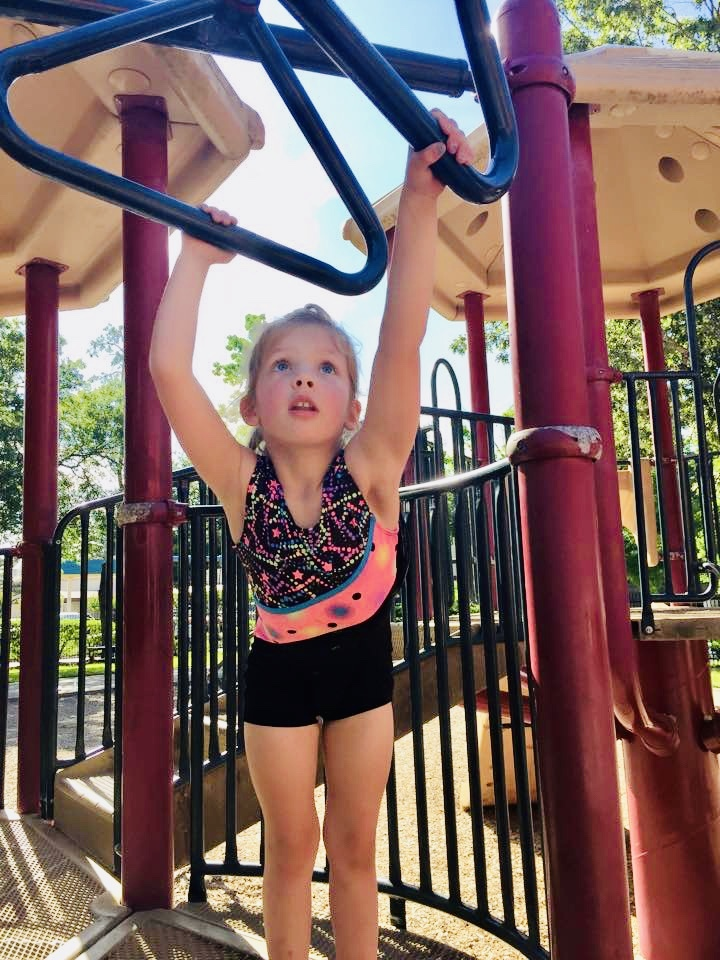 girl with belief on monkey bars | solid grip