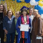 Gateway College and Career Academy graduate Alisha Foster holds her diploma while posing with her family at graduation
