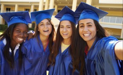 Four Gateway College and Career Academy students pose for a picture at graduation