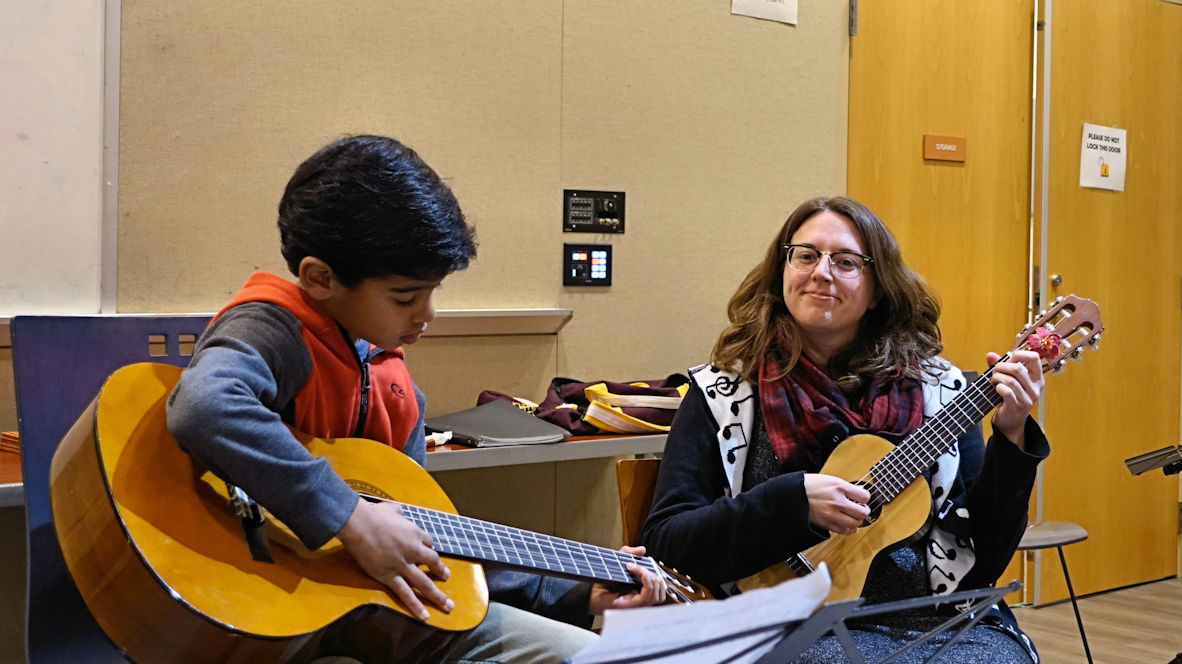 Photo of Melody Sheppard and her student performing at Open Mic