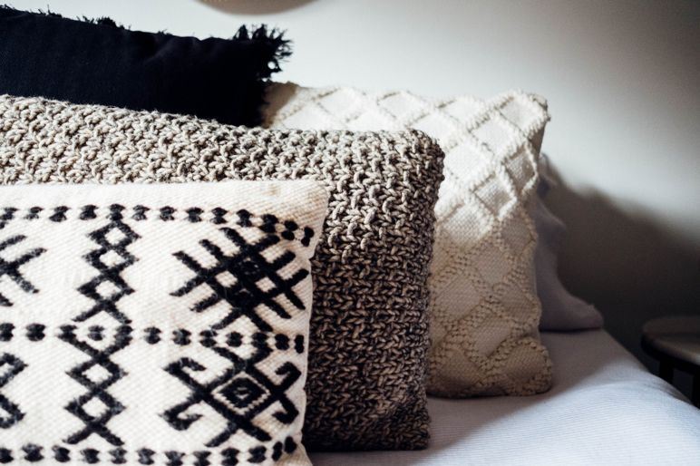 Mix and match patterned cushions for spring/summer 2019 interior trends