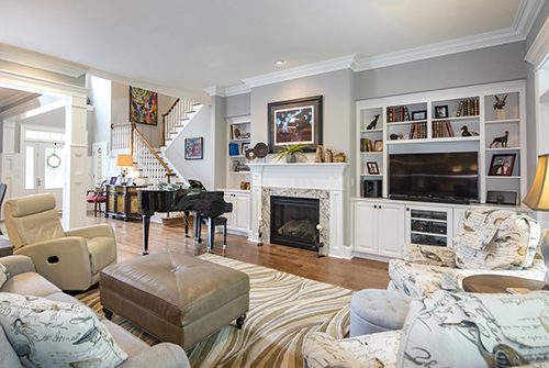 Great room with custom built in shelves and fireplace