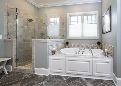 Master bathroom with walk in shower and soaking tub
