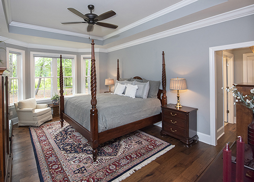 Master bedroom with tray ceiling and crown molding
