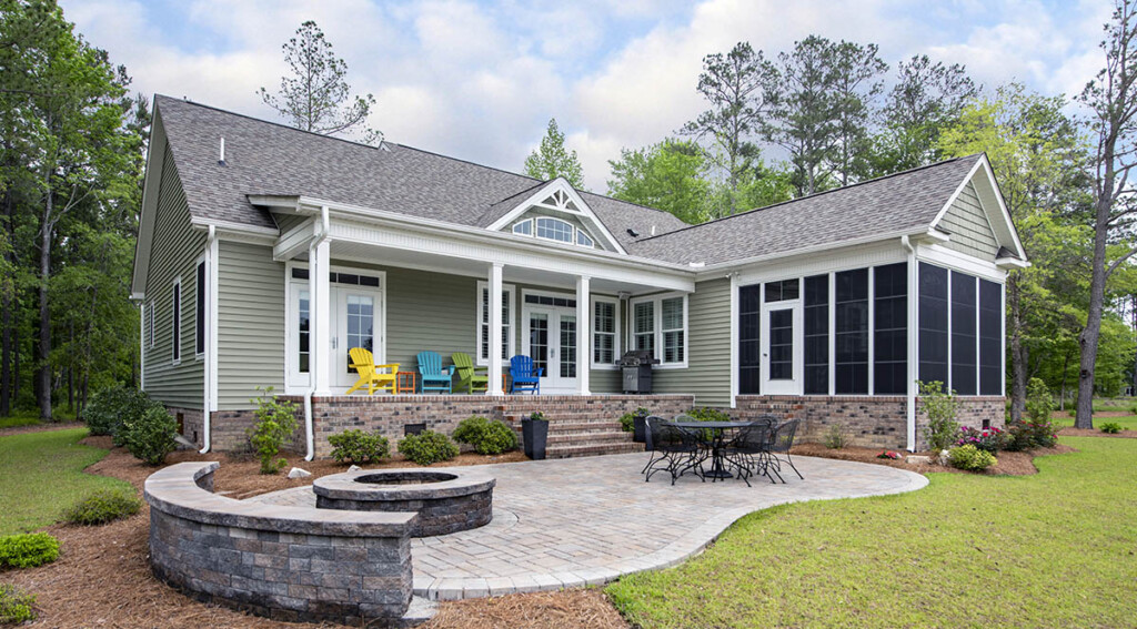 Custom home exterior with stone patio and firepit