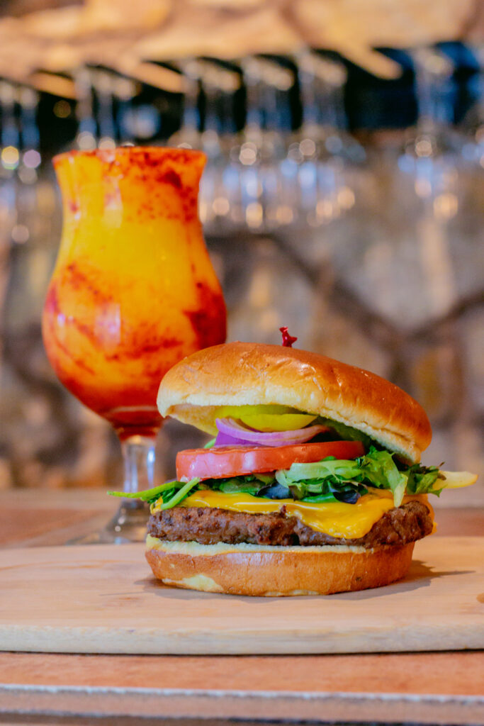 Our famous Bistro Burger paired with the delicious New Mexico Sunrise frozen wine cocktail.