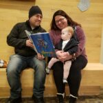 Families took time to read copies of the book in the lobby pre-show