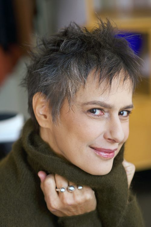 beautiful mature woman with pixie haircut smiling