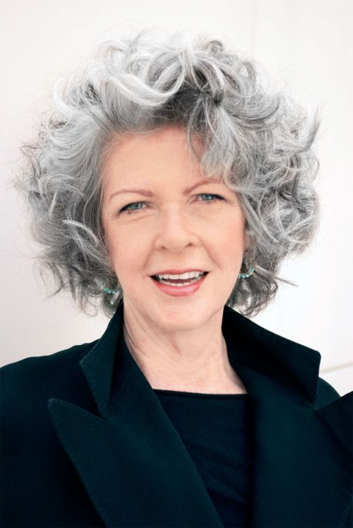 older woman with short wavy gray hair smiling