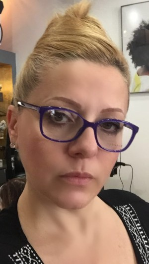 blonde woman wearing glasses