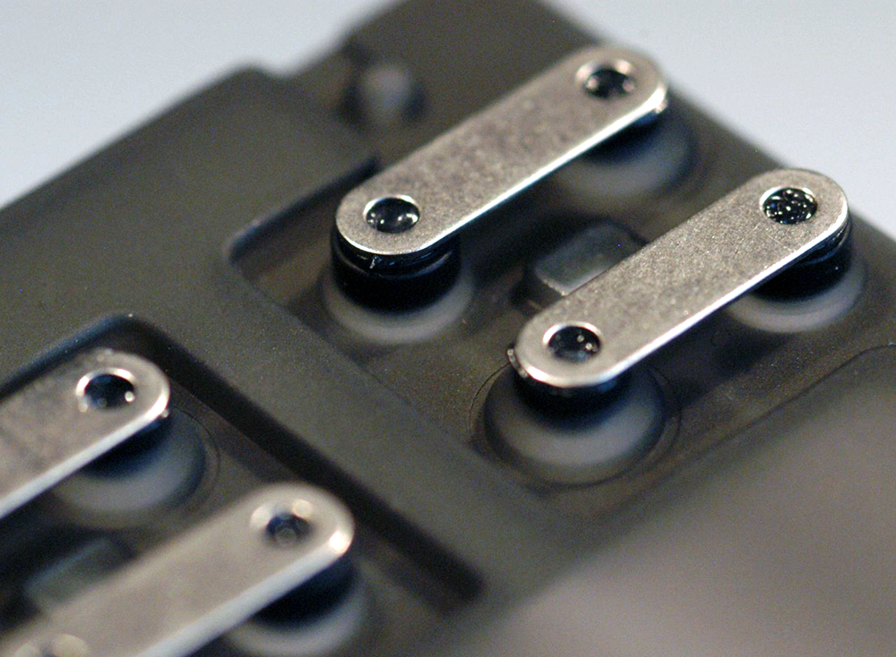 Metal plate rocker to create a double dent switch